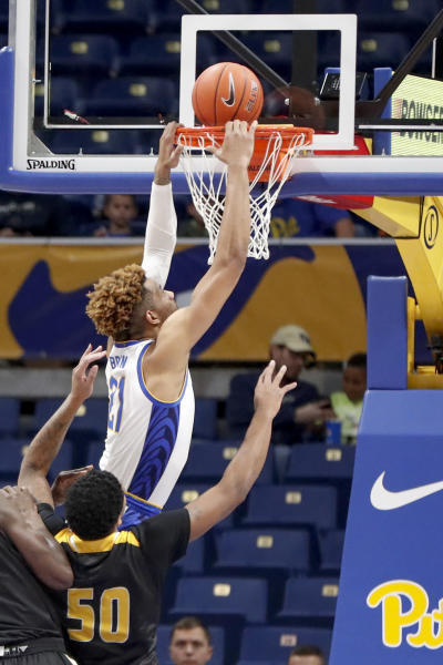 Pittsburgh's Terrell Brown (21) tries for a dunk over Arkansas-Pine Bluff's Chris Smith (50) during the first half of an NCAA college basketball game Thursday, Nov. 21, 2019, in Pittsburgh. (AP Photo/Keith Srakocic)