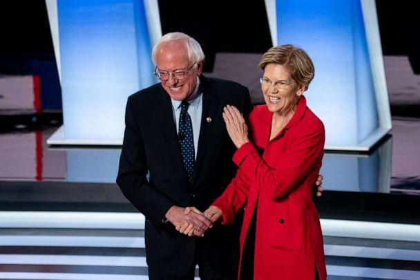 PHOTO: Sens. Bernie Sanders and Elizabeth Warren greet each other at the start of the first night of Democratic presidential debates at the Fox Theater in Detroit, July 30, 2019. (Erin Schaff/The New York Times via Redux, FILE)