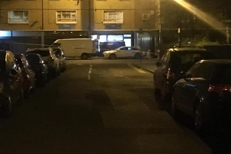 Murder scene: Forensic officers outside an off licence where a 21-year-old man was stabbed to death in Freemasons Road, Canning Town (Barney Davis)