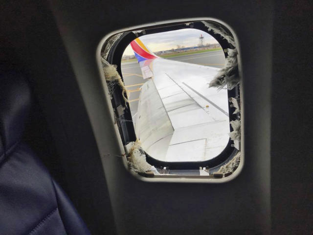 <p>This April 17, 2018 photo provided by Marty Martinez shows the window that was shattered after a jet engine of a Southwest Airlines airplane blew out at altitude, resulting in the death of a woman who was nearly sucked from the window during the flight of the Boeing 737 bound from New York to Dallas with 149 people aboard, shown after it made an emergency landing in Philadelphia. (Photo: Marty Martinez via AP) </p>