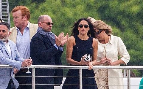 Mark Dyer (left) with Meghan Markle at the polo - Credit: David Hartley