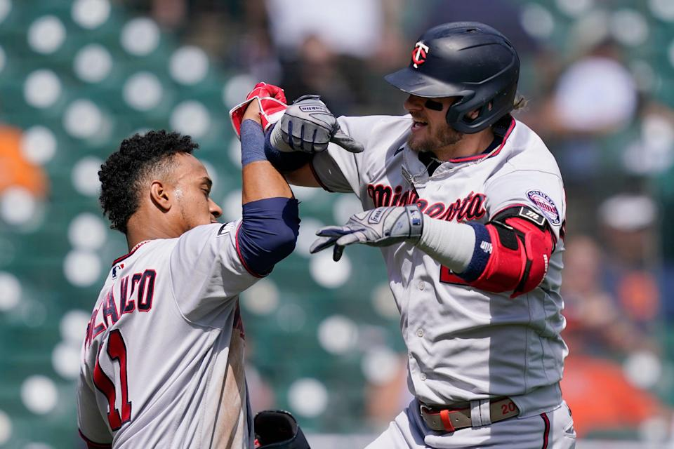 Twins designated hitter Josh Donaldson, right, is greeted by Jorge Polanco after they both scored on Donaldson's two-run home run during the fourth inning on Monday, Aug. 30, 2021, at Comerica Park.