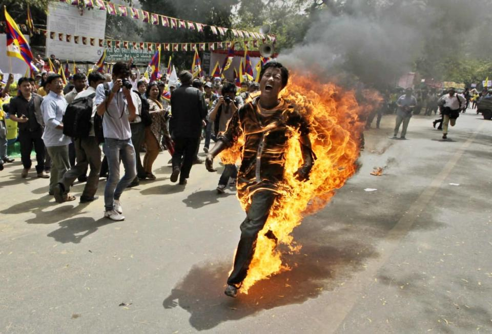 "<div class=""inline-image__caption""><p>In this March 26, 2012 photo, Tibetan exile Jamphel Yeshi screams as he runs engulfed in flames after setting himself on fire at a protest in New Delhi, India, against Chinese President Hu Jintao's visit to India. Yeshi died two days later while hundreds of other activists were being held without charge before the president's arrival. Hu arrived in New Delhi for a summit with India, Russia, Brazil and South Africa.</p></div> <div class=""inline-image__credit"">Manish Swarup/AP</div>"