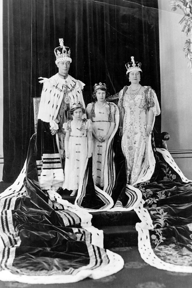 <p>With her fatherKing George VI, her motherQueen Elizabeth,and hersister Princess Margaret<span></span>in their coronation robes in 1937</p>