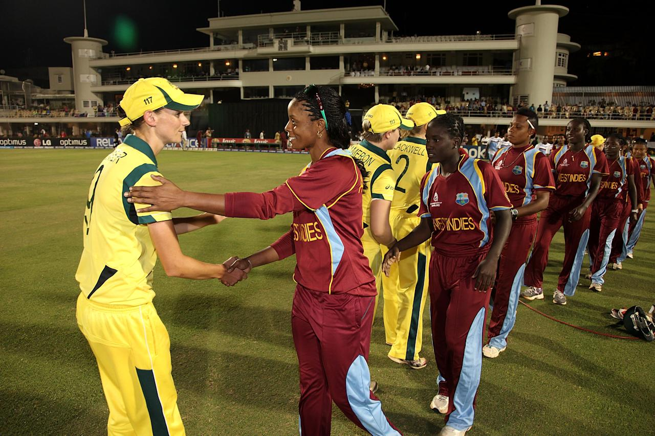 MUMBAI, INDIA - FEBRUARY 17:  Julie Hunter of Australia shakes hands with Merissa Aguilleira of West Indies  after defeating the West Indies the final between Australia and West Indies of the Women's World Cup India 2013 played at the Cricket Club of India ground on February 17, 2013 in Mumbai, India. (Photo by Graham Crouch/ICC via Getty Images)