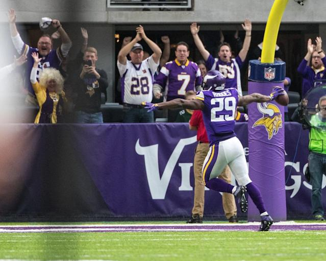 Nov 20, 2016; Minneapolis, MN, USA; Minnesota Vikings cornerback Xavier Rhodes (29) returns an interception 100 yards for a touchdown during the second quarter against the Arizona Cardinals at U.S. Bank Stadium. Mandatory Credit: Brace Hemmelgarn-USA TODAY Sports