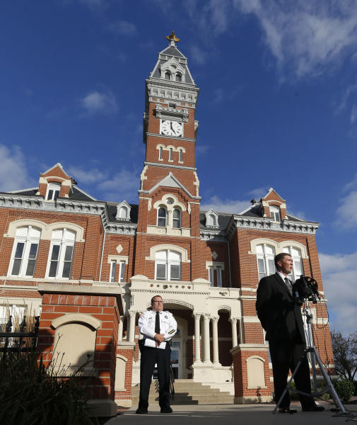 County prosecutor Robert Rice, right, and Sheriff Darren White hold a news conference outside the Nodaway County Court House in Maryville, Mo., Wednesday, Oct. 16, 2013. (AP Photo/Orlin Wagner)