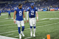 Indianapolis Colts quarterback Carson Wentz (2) walks off the filed with quarterback Jacob Eason (9) following an NFL football game against the Los Angeles Rams, Sunday, Sept. 19, 2021, in Indianapolis. Los Angeles won 27-24. (AP Photo/AJ Mast)