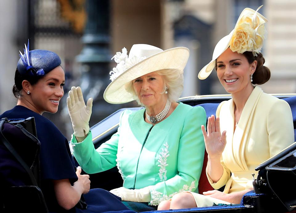 (Left to right) The Duchess of Sussex, Duchess of Cornwall and the Duchess of Cambridge make their way along The Mall to Horse Guards Parade, in London, ahead of the Trooping the Colour ceremony, as Queen Elizabeth II celebrates her official birthday.