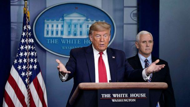 PHOTO: President Donald Trump gestures as Vice President Mike Pence looks on during a briefing on the coronavirus pandemic in the press briefing room of the White House, on March 26, 2020, in Washington. (Drew Angerer/Getty Images)