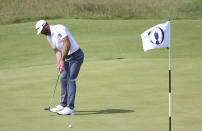 United States' Dustin Johnson putts on the 16th green during a practice round for the British Open Golf Championship at Royal St George's golf course Sandwich, England, Tuesday, July 13, 2021. The Open starts Thursday, July, 15. (AP Photo/Ian Walton)