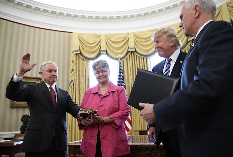 U.S. President Donald Trump (2nd R) watches as Jeff Sessions (L) is sworn in as the new U.S. Attorney General by U.S. Vice President Mike Pence (R) in the Oval Office of the White House February 9, 2017 in Washington, D.C. (Photo by Win McNamee/Getty Images)