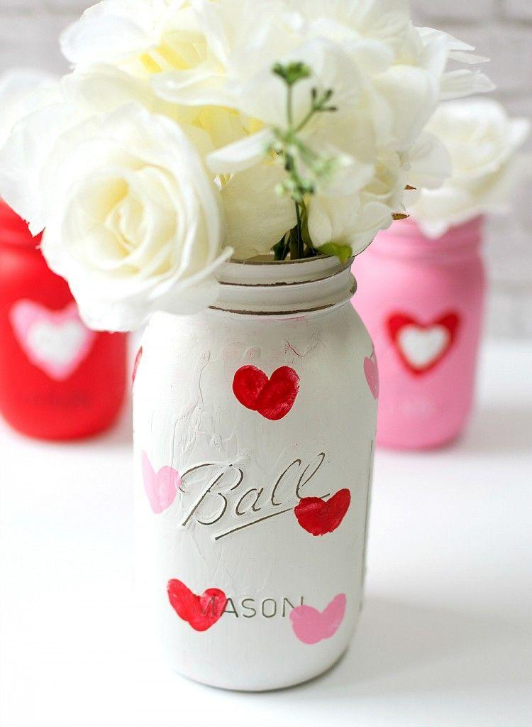 """<p>For each heart, add your fingerprint to a painted mason jar, then have your partner add theirs. On Valentine's Day, you'll have a perfect place to put your flowers. </p><p><em><a href=""""https://www.itallstartedwithpaint.com/valentine-kid-craft-thumbprint-heart-jars/"""" rel=""""nofollow noopener"""" target=""""_blank"""" data-ylk=""""slk:Get the tutorial at It All Started with Paint »"""" class=""""link rapid-noclick-resp"""">Get the tutorial at It All Started with Paint »</a></em></p>"""