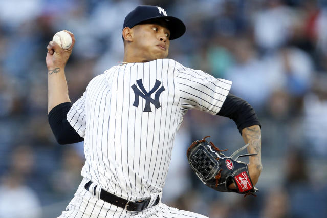 New York Yankees pitcher Jonathan Loaisiga delivers during the third inning of a baseball game against the Tampa Bay Rays, Friday, June 15, 2018, in New York. Loaisiga was making his major league debut. (AP Photo/Adam Hunger)
