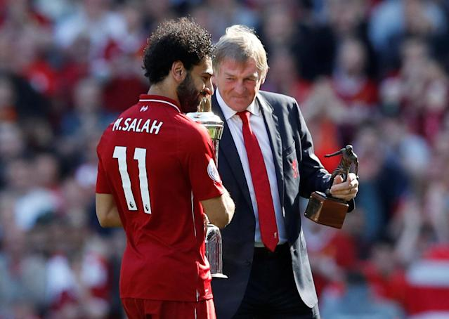 "Soccer Football - Premier League - Liverpool vs Brighton & Hove Albion - Anfield, Liverpool, Britain - May 13, 2018 Liverpool's Mohamed Salah is presented with awards by Kenny Dalglish after the match Action Images via Reuters/Carl Recine EDITORIAL USE ONLY. No use with unauthorized audio, video, data, fixture lists, club/league logos or ""live"" services. Online in-match use limited to 75 images, no video emulation. No use in betting, games or single club/league/player publications. Please contact your account representative for further details."