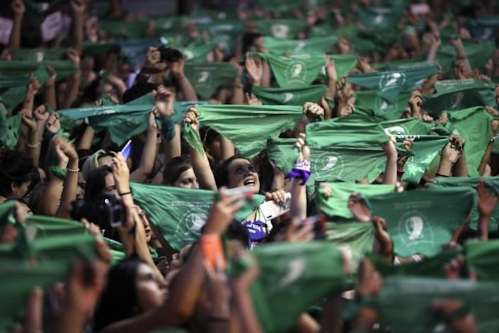 Thousands of pro-choice activists, including feminist groups from the U.S. and Chile, demonstrate in favor of decriminalizing abortion, outside Congress in Buenos Aires, Argentina, Wednesday, Feb. 19, 2020. Waving their iconic green handkerchiefs, the demonstrators are demanding the issue be included in this year's parliamentary agenda. (AP Photo/Natacha Pisarenko)