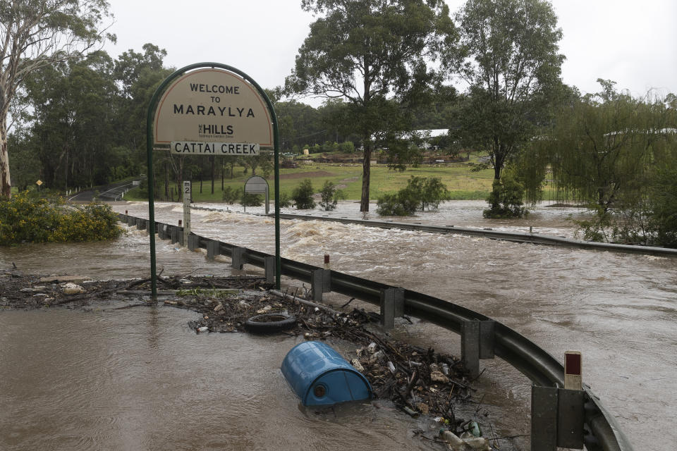 Heavy floodwaters cover a roadway at Cattai Creek on March 20, 2021 in Maraylya, Australia. Source: AAP