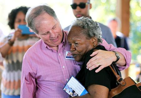 Democratic Alabama U.S. Senate candidate Doug Jones greets a supporter while campaigning at an outdoor festival in Grove Hill, Alabama.   REUTERS/Mike Kittrell