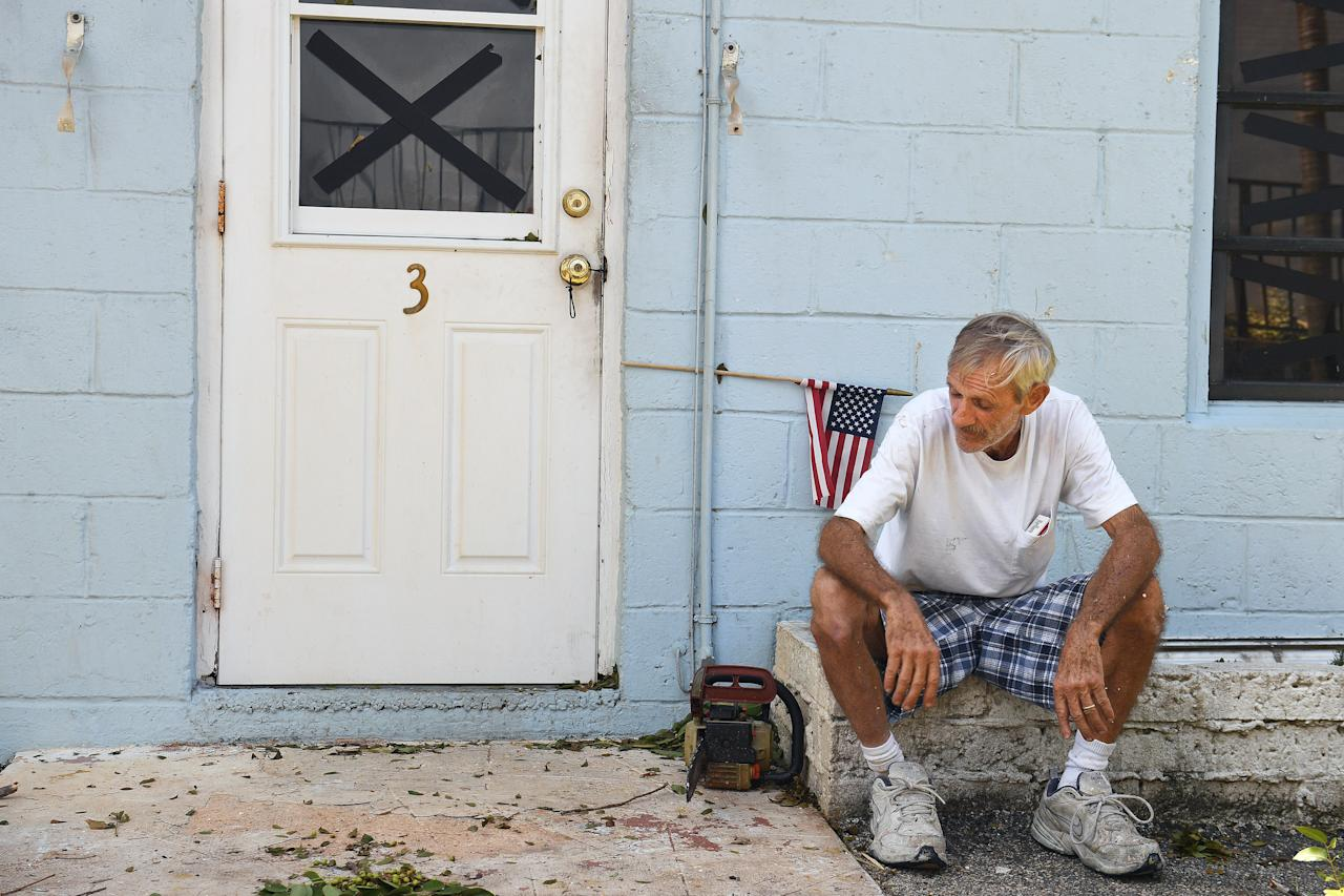 <p>Manager of the Coral Sands Trailer Park, Bruce Ramsey takes a break from cleaning up debris that littered the Florida Keys complex following Hurricane Irma on Sept. 12, 2017 in Key Largo, FL. (Photo: Matt McClain/The Washington Post via Getty Images) </p>