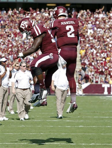 Texas A&M running back Christine Michael (33) and quarterback Johnny Manziel (2) celebrate a touchdown during the first half of an NCAA college football game against LSU, Saturday, Oct. 20, 2012, in College Station, Texas. (AP Photo/Eric Kayne)