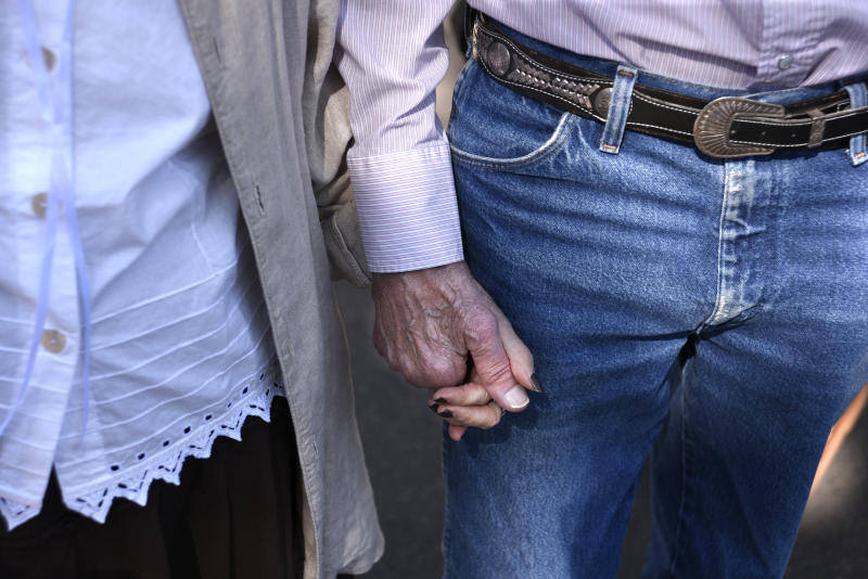 SANTA FE, NEW MEXICO - JULY 28, 2018: A couple hold hands at an outdoor art show in Santa Fe, New Mexico. (Photo by Robert Alexander/Getty Images)