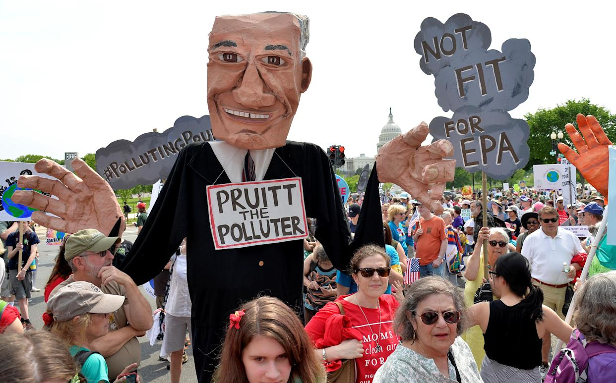 """<span class=""""s1"""">A giant puppet depicting EPA Administrator Scott Pruitt joined the People's Climate March in Washington in April 2017. (Photo: Mike Theiler/Reuters)</span>"""