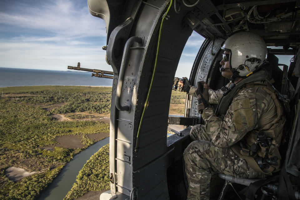 A supplied image obtained on Tuesday, July 16, 2019, shows a crew chief with Helicopter Sea Combat Squadron 85 (HSC-85) scanning the skies while on a mission to emplace U.S. and Australian Special Operations Forces (SOF) during Talisman Sabre, July 12, 2019. Talisman Sabre is a bilateral exercise that tests the two forces combat training, readiness and interoperability. (AAP Image/U.S. Marine Corps, Lance Cpl. Nicole Rogge) NO ARCHIVING, EDITORIAL USE ONLY