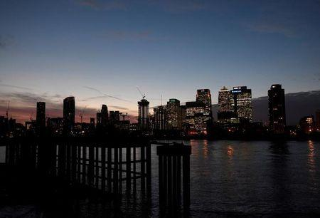 FILE PHOTO: The Canary Wharf financial district is seen at dusk in London