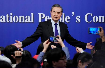 China's Foreign Minister Wang Yi speaks to the media after a news conference during the NPC in Beijing