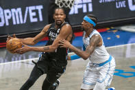 Brooklyn Nets forward Kevin Durant drives past Los Angeles Lakers guard Kentavious Caldwell-Pope in the first half of an NBA basketball game, Saturday, April 10, 2021, in New York. (AP Photo/Corey Sipkin)