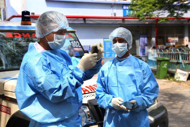 A medical team in PPE kits on duty of the nationwide lockdown to check the spread of coronavirus, near Government Hospital, on April 9, 2020 in Kolkata.