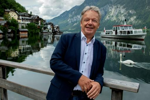 Hallstatt's Alexander Scheutz says the village wants to trade quality for quantity -- the village of 750 residents welcomed one million tourists per year