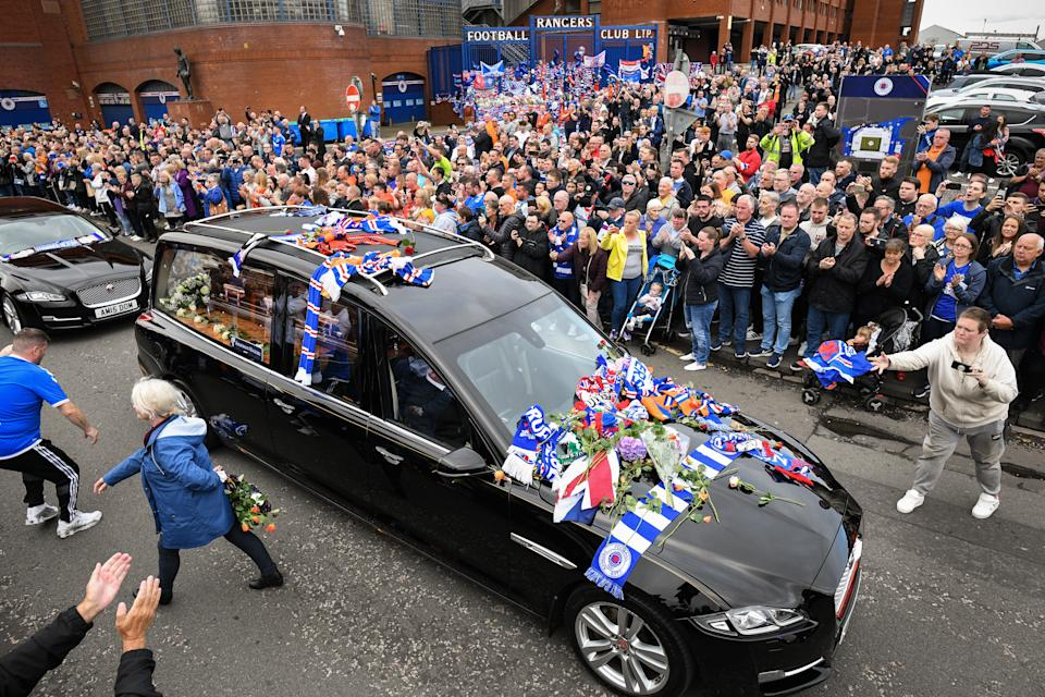 Fans pay their respects to Ricksen as his funeral cortege makes its way past the ground. (Photo by Jeff J Mitchell/Getty Images)