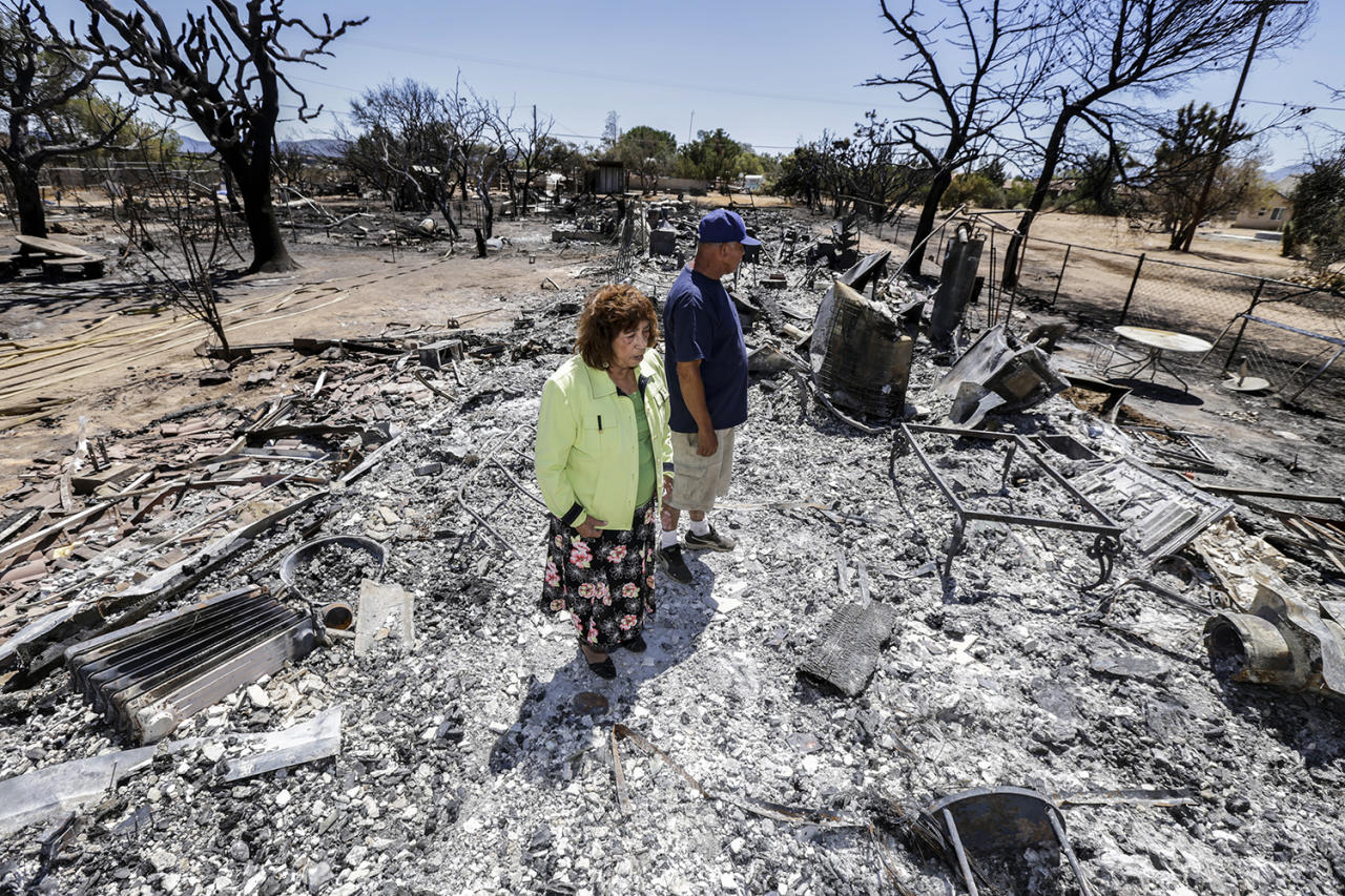 <p>Miguel and Mabel Ramos, both 73-year-old, are traumatized by the devastation caused by Blue Cut Fire that swept through his residence, on 6500 block of Oak Hill Road, burning a guest house to ground, two cars and killing about 135 animals in Oak Hills, Calif., on Aug. 19, 2016 (Irfan Khan/Los Angeles Times via Getty Images) </p>