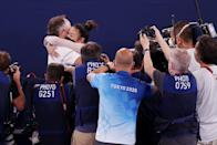 """<p>Upon learning that she had won gold, Lee hugged her coach Jess Graba, who has been her coach since elementary school.</p> <p>""""She's tough as nails,"""" Graba told the <a href=""""https://www.washingtonpost.com/sports/olympics/2021/07/29/olympic-gymnastics-all-around-final/"""" rel=""""nofollow noopener"""" target=""""_blank"""" data-ylk=""""slk:Washington Post"""" class=""""link rapid-noclick-resp""""><em>Washington Post</em></a>. """"People don't see that. They don't know how hurt she is. They don't know how stressed out she is. They don't know how nervous she is.""""</p>"""