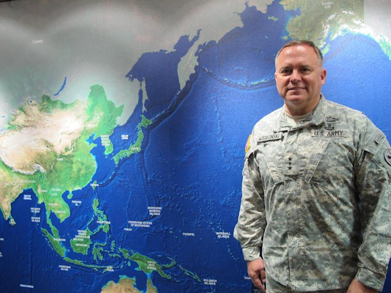 In a Sept. 21, 2012 photo, Lt. Gen. Francis J. Wiercinski, the commander of U.S. Army Pacific, poses before a map highlighting his area of responsibility at Fort Shafter, Hawai. The leader of U.S. Army forces in Asia and the Pacific said his soldiers will be able to exercise more with other nations as the U.S. draws down from Afghanistan and the military refocuses its attention on the region.  (AP Photo/Audrey McAvoy)