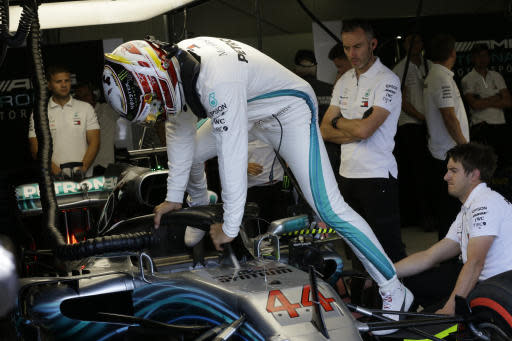 Mercedes driver Lewis Hamilton of Britain gets in his car in the team box during the third free practice at the Monaco racetrack, in Monaco, Saturday, May 26, 2018. The Formula one race will be held on Sunday. (AP Photo/Claude Paris)