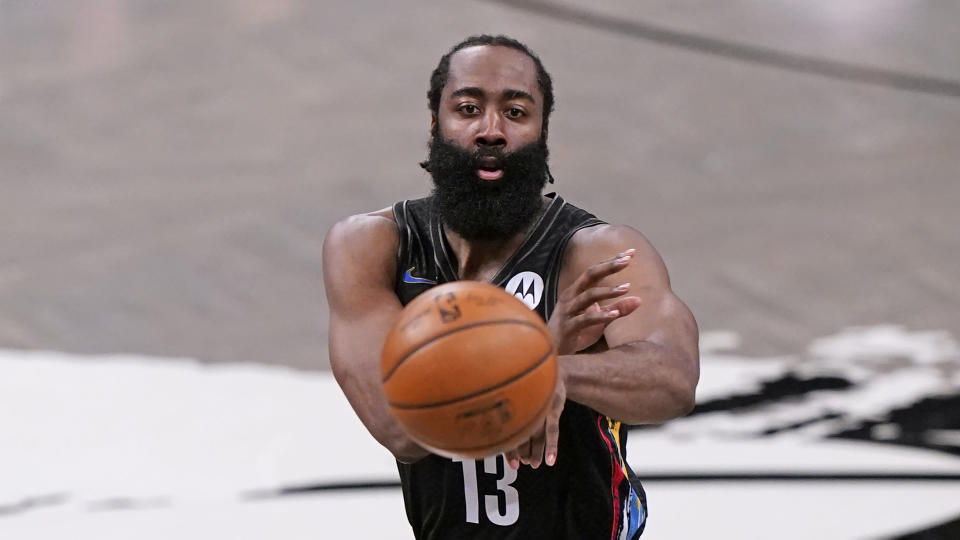 Brooklyn Nets guard James Harden (13) passes the ball during the second half of Game 2 of an NBA basketball first-round playoff series against the Boston Celtics, Tuesday, May 25, 2021, in New York. (AP Photo/Kathy Willens)