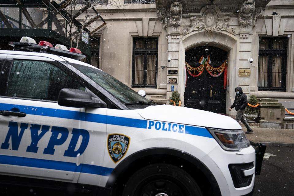 New York Police Department vehicles park outside the Consulate General of India during a protest, Tuesday, Jan. 26, 2021, in the Manhattan borough of New York. Tens of thousands of protesting farmers have marched, rode horses and drove long lines of tractors into India's capital, breaking through police barricades to storm the historic Red Fort. The farmers have been demanding the withdrawal of new laws that they say will favor large corporate farms and devastate the earnings of smaller scale farmers. Republic Day marks the anniversary of the adoption of India's constitution on Jan. 26, 1950. (AP Photo/John Minchillo)