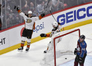 Anaheim Ducks left wing Rickard Rakell (67) celebrates his overtime goal with defenseman Christian Djoos (29), as Colorado Avalanche defenseman Samuel Girard (49) skates by at the end of an NHL hockey game Wednesday, March 4, 2020, in Denver. The Ducks won 3-2. (AP Photo/John Leyba)