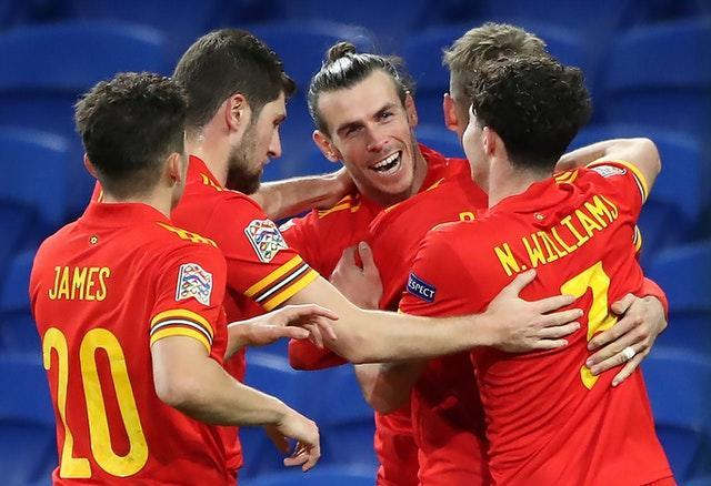 Wales' Gareth Bale (centre) celebrates the opening goal with his team-mates