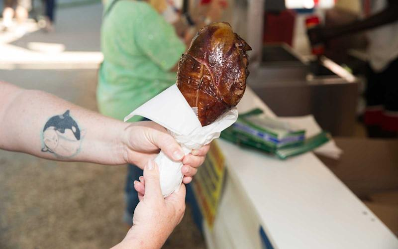 It my have only been 11 a.m., but this fairgoer started the day with a massive turkey leg breakfast. | Jason Bergman