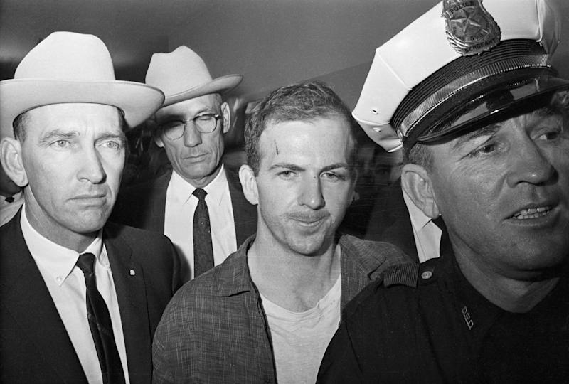 Twenty-four-year-old ex-marine Lee Harvey Oswald is shown after his arrest here on November 22. He received a cut on his forehead and blackened left eye in scuffle with officers who arrested him.