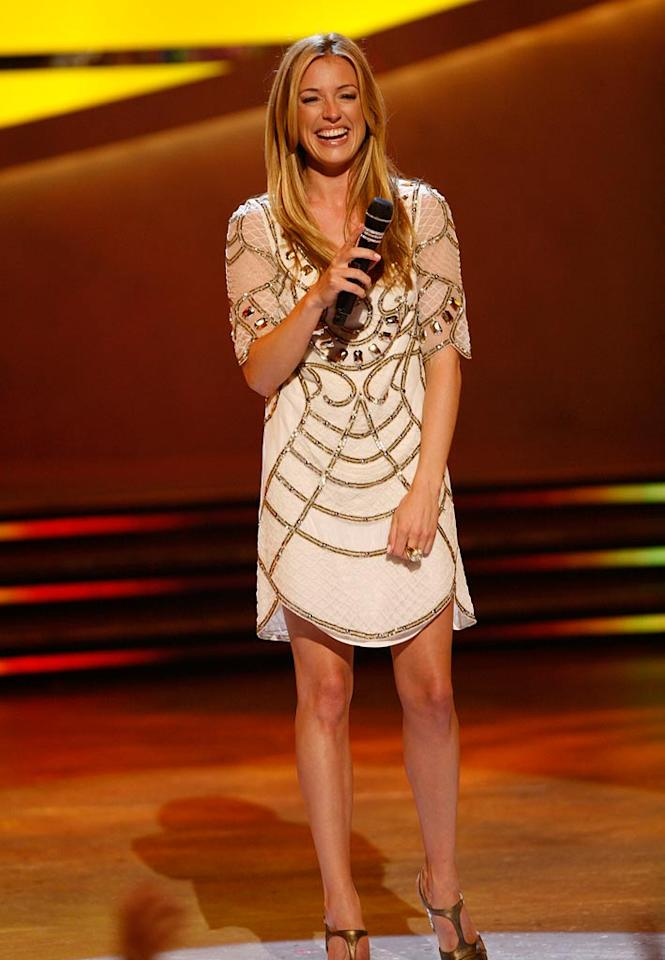 "<a href=""/cat-deeley/contributor/2212390"">Cat Deeley</a> stayed true to her UK roots, showing off her gorgeous gams in a gem and sequin-embellished tunic from British label Temperley London and a pair of T-strap Louboutins when she introduced the Top 20 contestants on Season 5 of <a href=""/so-you-think-you-can-dance/show/36160"">""So You Think You Can Dance.""</a>"