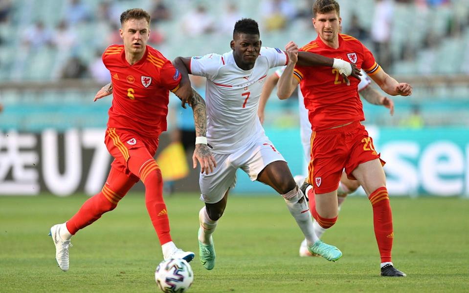 Breel Embolo bursts past Joe Rodon and Chris Mepham during Wales' 1-1 draw with Switzerland - GETTY IMAGES