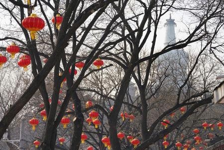 Decorations for the upcoming Chinese Lunar New Year are pictured near a park on a polluted day in Beijing, China February 13, 2018. Picture taken February 13, 2018. REUTERS/Jason Lee