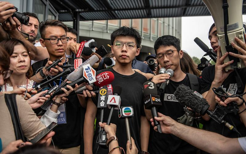 Joshua Wong speaks to the media shortly after being released from prison - Getty Images AsiaPac