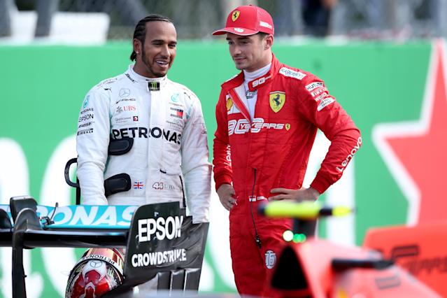 Charles Leclerc talks with Lewis Hamilton. (Credit: Getty Images)