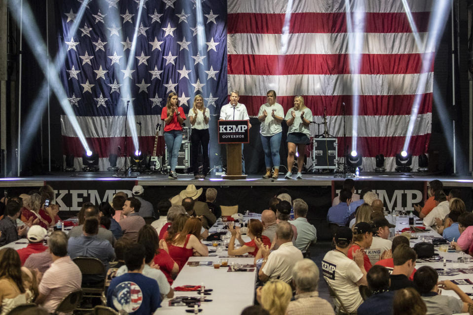 Gov. Brian Kemp announces his bid for re-election at the Georgia National Fairgrounds surrounded by his family on Saturday, July 10, 2021 in Perry, Ga. (Clay Teague/The Macon Telegraph via AP)