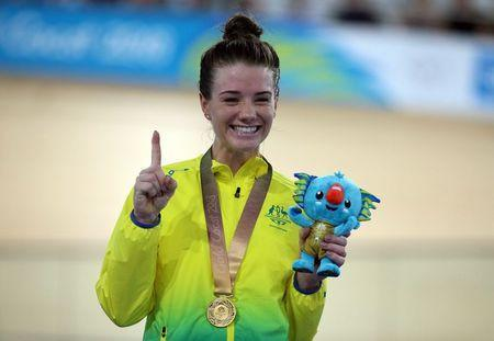 Track Cycling - Gold Coast 2018 Commonwealth Games - Women's 10km Scratch Race Finals - Anna Meares Velodrome - Gold Coast, Australia - April 8, 2018. Amy Cure of Australia celebrates on the podium after winning a gold medal. REUTERS/Athit Perawongmetha